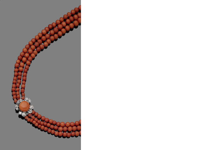 A three-strand coral necklace