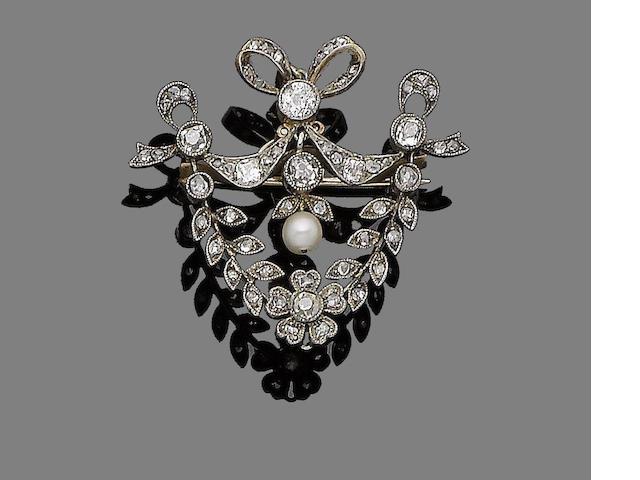 A pearl and diamond brooch/pendant,