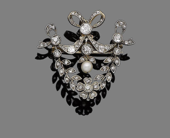 A pearl and diamond brooch/pendant,