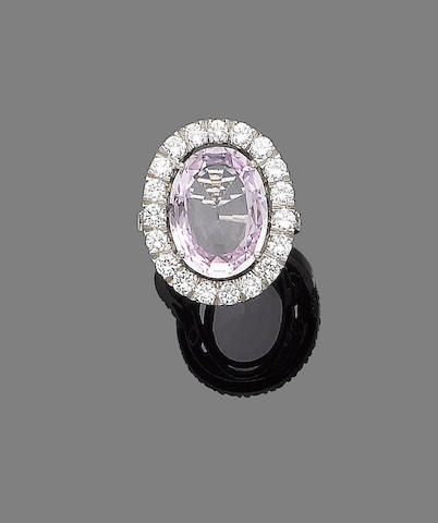 A pink topaz and diamond dress ring