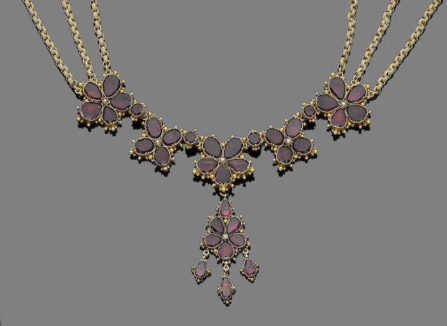 A gold, seed pearl and foiled garnet necklace,