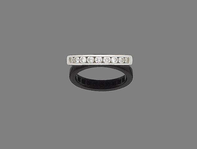 A diamond half-hoop ring, by Tiffany & Co.