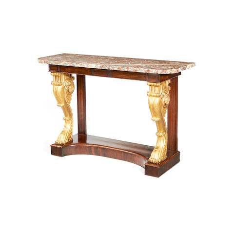 A William IV rosewood and parcel gilt console table