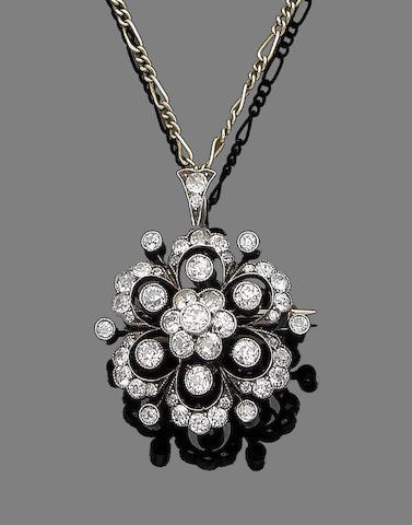 A diamond flower brooch/pendant,