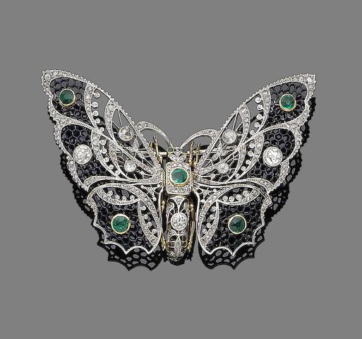 An emerald and diamond butterfly brooch