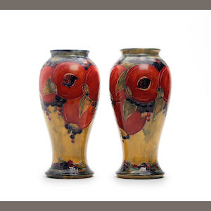A pair of William Moorcroft 'Pomegranate' design vases Circa 1912-14