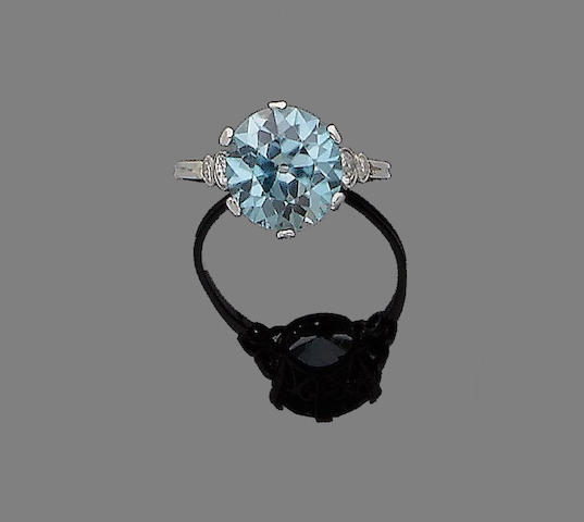 A blue zircon and diamond ring
