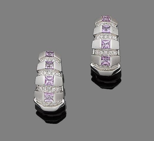 A pair of pink sapphire and diamond hoop earrings