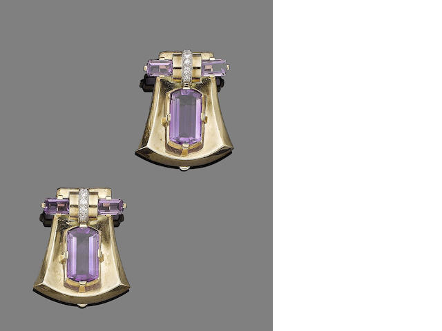 A pair of amethyst and diamond clip brooches by Charlton & Co., (2)