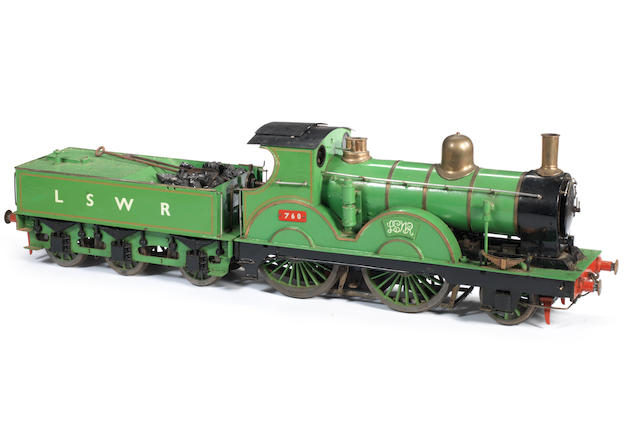 A 3 1/2in gauge live steam model of a LSWR 2-4-0 locomotive No.760 and tender