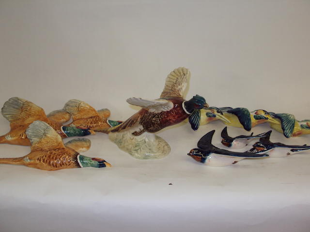Three sets of Beswick bird wall plaques, and a Beswick pheasant