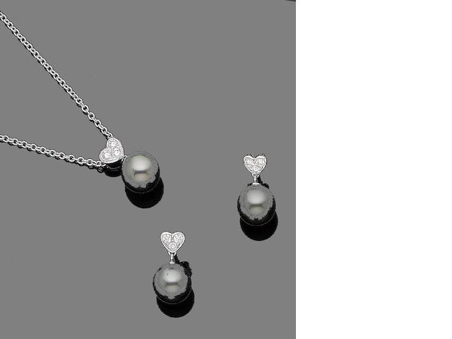 A cultured pearl and diamond pendant and earring suite, by Mikimoto (2)