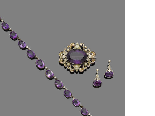 An amethyst rivière necklace, circa 1900, a mid 19th century amethyst brooch and a pair of amethyst pendent earrings (3)