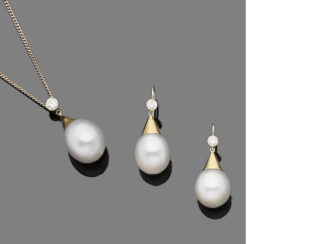 A cultured pearl and diamond necklace and earring suite (2)