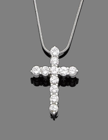 A diamond cross pendant necklace,