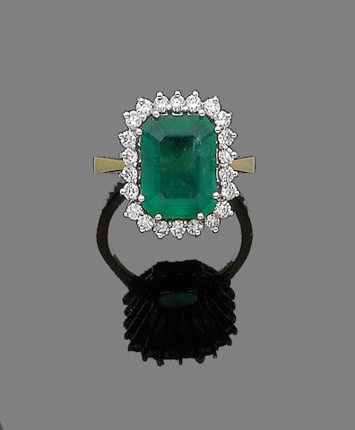 A gold, emerald and diamond cluster ring