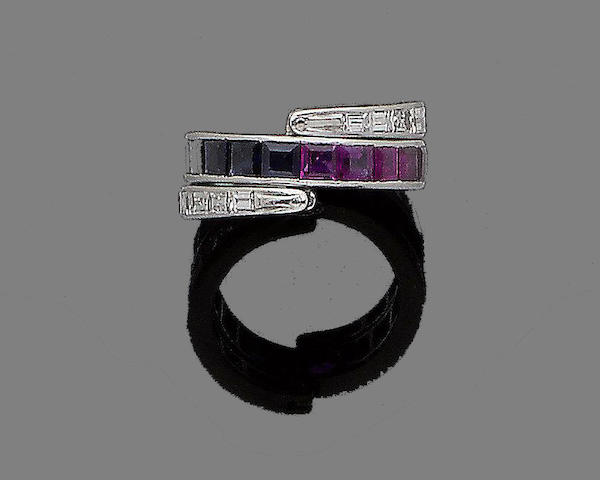 A sapphire, ruby and diamond swivel ring