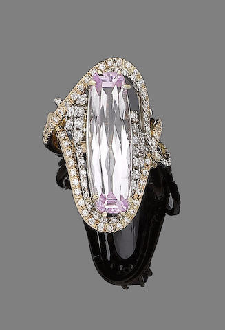 A kunzite and diamond dress ring