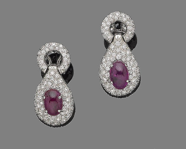A pair of ruby and diamond earrings
