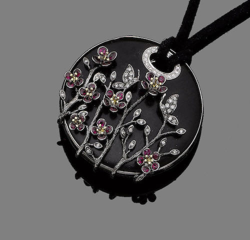 A wood, ruby and diamond pendant necklace