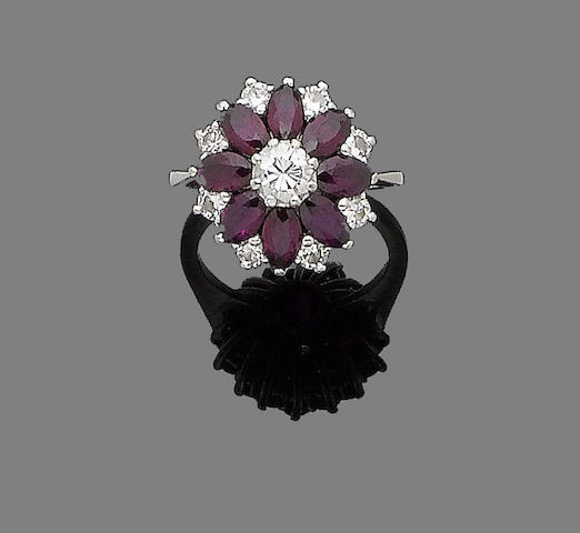 A ruby and diamond cluster ring, by T O'Donoghue,