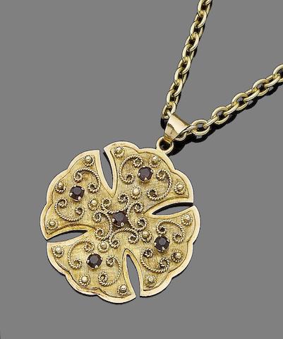 A gem-set cross pendant necklace