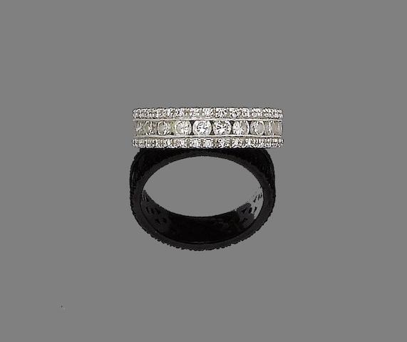 A diamond eternity ring, by Mappin & Webb,