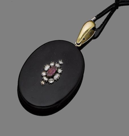 A mourning ebonite and gem-set locket pendant,