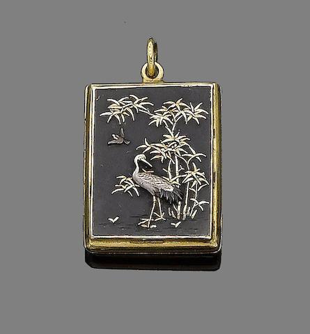 A copper and gold 'Shakudo' locket/pendant,