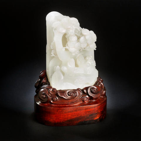 A large Chinese carved white jade boulder