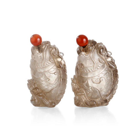 A pair of Chinese carved rock crystal snuff bottles