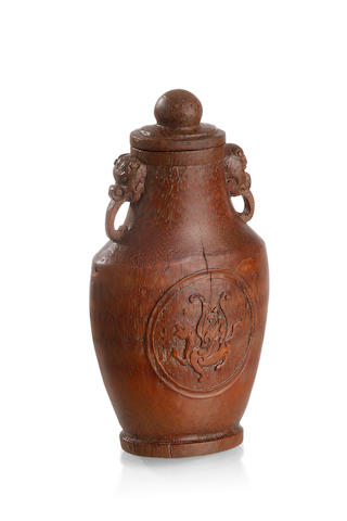 A small Chinese carved bamboo bottle-shaped vase and cover