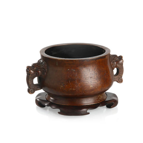 A Chinese 'shou' bronze censer with lion handles Three-character studio mark