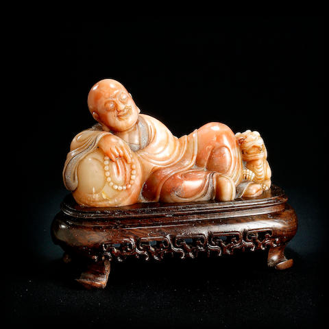 A Chinese furong soapstone reclining Arhat Qing dynasty
