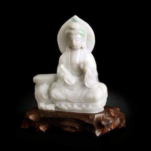 A Chinese carved jadeite guanyin