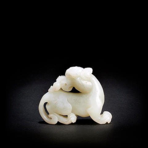 A Chinese carved white jade mythical beast