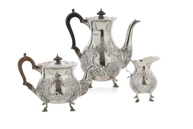 An Edwardian  silver  three piece tea and coffee service   Goldsmiths and Silversmiths Company, Teapot and coffee pot London 1902, Creamer London 1903  (3)