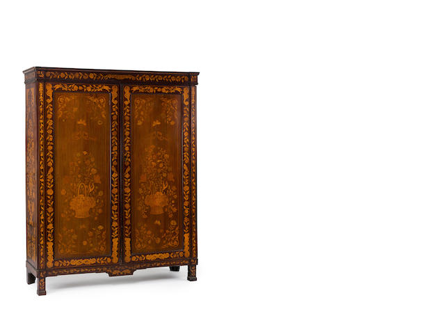 An 18th century European mahogany and marquetry inlaid two door cupboard