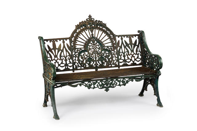 A late Victorian green painted cast iron garden bench in the Coalbrookdale 'Peacock' pattern