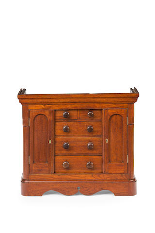 A 19th century Australian  cedar miniature wardrobe
