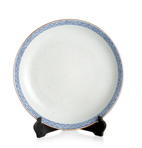 A large Chinese carved blue-and-white plate Kangxi