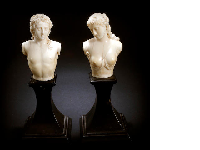 A 19th century  carved ivory  pair of busts of Bacchus and Aphrodite