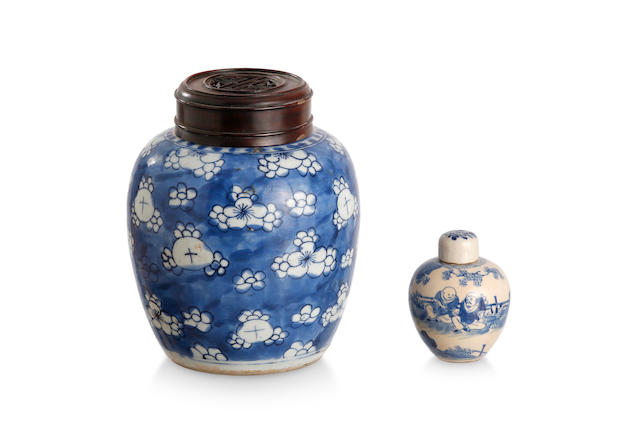 Two blue and white jars with lids The large jar of Kangxi period; the small jar with six-character Kangxi mark to the base, mid to late Qing