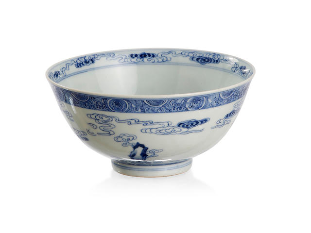 A Chinese carved blue-and-white bowl Six-character Qianlong seal mark to the base, late Qing
