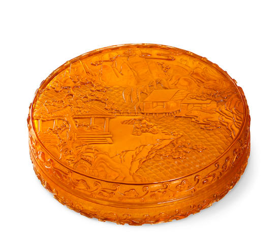 A large Chinese amber glass circular box and cover