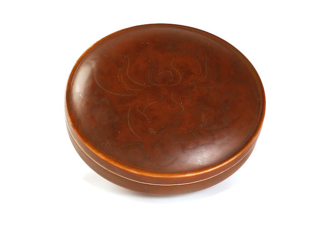 A Ding-StyLe circular powder box Marked 'Yi Ding' to the base