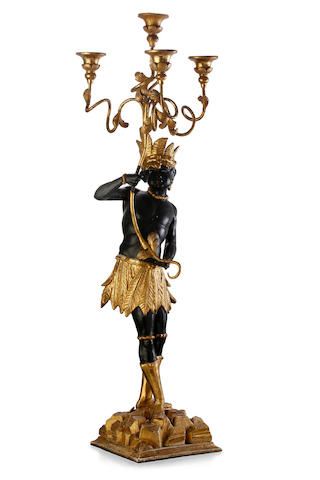An 18th century Italian painted and gilt decorated blackamoor figure