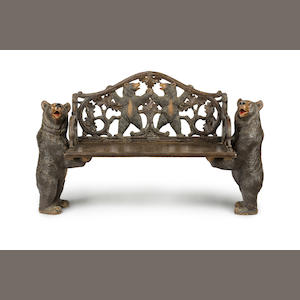 A 'Black Forest'  carved and stained wood benchLate 19th/early 20th century