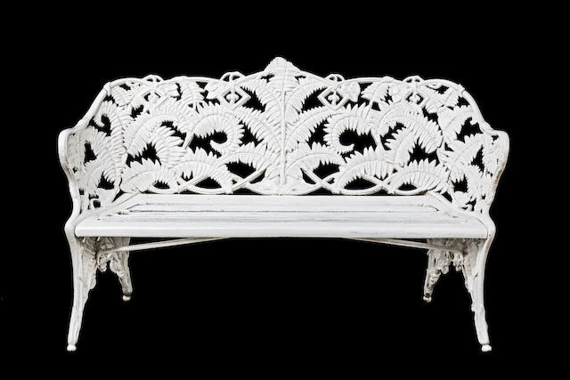 A late Victorian Coalbrookdale 'Fern and Blackberry' pattern white painted cast iron garden bench
