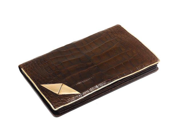 A 9 carat gold trimmed crocodile leather clutch bag the corner gold mounts marked T.H.L, London 1929